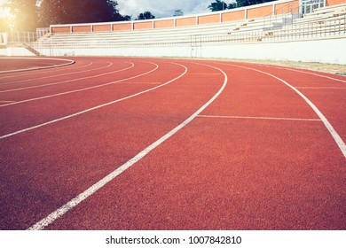 Red running track lines in stadium.