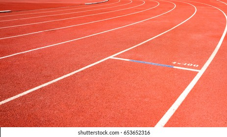 red running track on athletic stadium