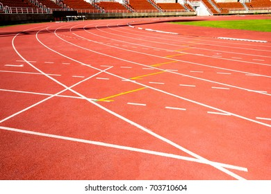 red running track on athletic stadium , background texture