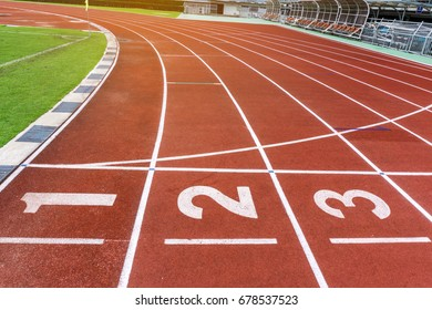 Red running track in stadium with number in lanes. Business Investment Competition Concepts