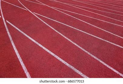 Red running track in stadium. White line