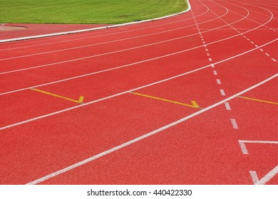 Red running tracks white lines separated in stadium for competition or business concept