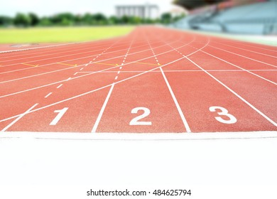 Red running tracks white numbers one two three in stadium for competition or ordering concept