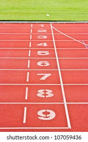 Red running tracks.Numbers one through nine.
