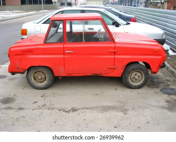 Red russian car, made specially for disabled persons