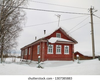 Red Russian rural house at winter season