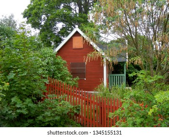 Red rustic tiny house in Sweden