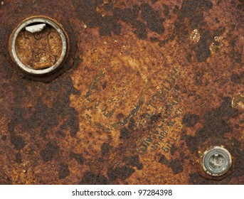 Red rusty grungy old metal texture with lids for use as background in various designs.