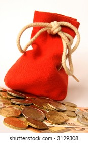 A red sack filled with money and Euro coins in front of it before a light background