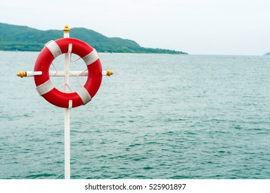 Red safe ring on pier in front of Water of Siam gulf. Emergency help theme background with space for your logo