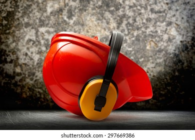 Red safety helmet with earphones in closeup