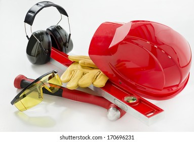 Red safety helmet with earphones and gloves
