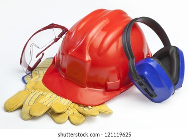 Red safety helmet with goggles and gloves headphones