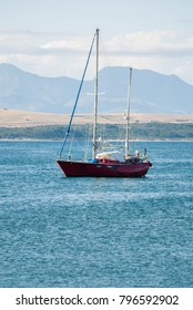 A red sailing boat on the menai strait, Anglesey