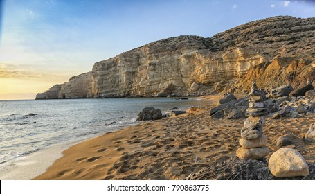 Red Sand Beach or Kokkini Ammos in Greek is a nudist beach near Matala in Crete island in Greece. Golden soft sand and steep cliffs are the landmarks of this beach. Matala, Greece - 5 May 2017