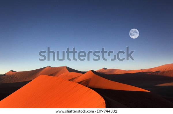 Red sand dune with full moon, Sossusvlei, Namibia