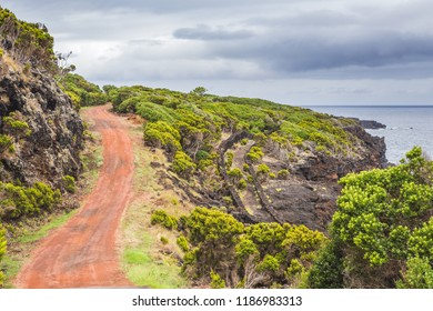 Red sand road crossing vineyards in Pico Island, Azores
