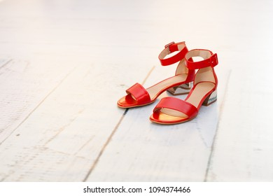 Red sandals on a low heel on the floor