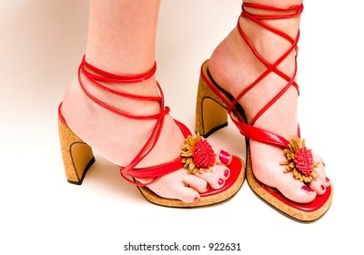 Red sandals and red toenails