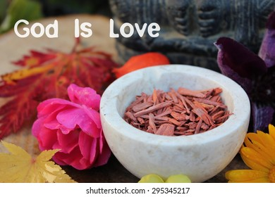 Red Sandalwood chips cut (santali rubri from Gabun) stone bowl ritual offering indian elephant god ganesha autumn flowers leaves (rose, calendula) vivid colors god is love written transparent postcard