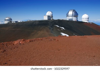 Red sands of Mauna Kea volcano, a popular mountain to hike and climb on the Big Island of Hawaii, USA located on The Ring of Fire with Astronomic Observatories on top
