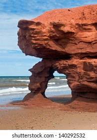 A red sandstone arch eroded by the sea along Prince Edward Island's Seaview Coast, Canada. Note: It  is reported that this arch has been claimed by the sea.