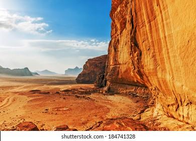 Red sandstone cliff in the desert of Wadi Rum, Jordan, Middle East