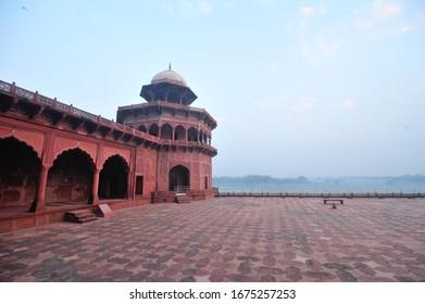 Red sandstone platform next to Yamuna River at Taj Mahal Complex in Agra, India.
