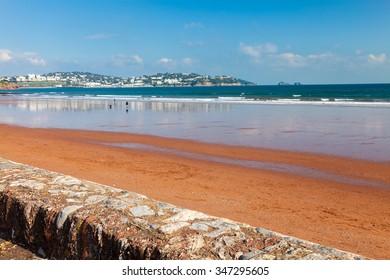 Red sandy beach at Preston Sands Paignton Torbay Devon England UK Europe