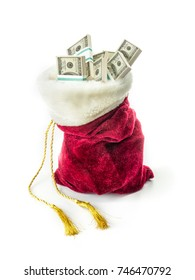 Red Santa Claus bag filled with 100 dollar banknotes shot on white background