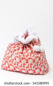 red Santa Claus bag with gifts