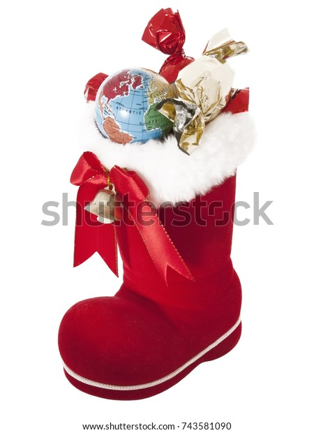 A red Santa Claus boot with a bell full of New Year gifts and a globe. The concept of Christmas, New Year in every house on the planet.