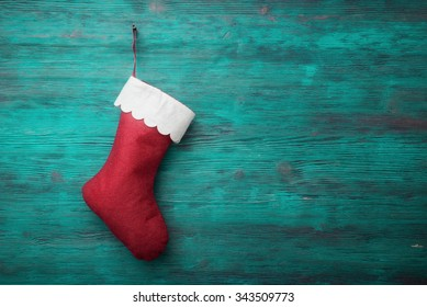 Red Santa sock on wooden background
