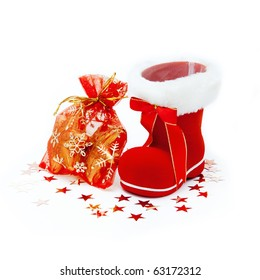 Red Santa's boot with giftbag isolated on white background