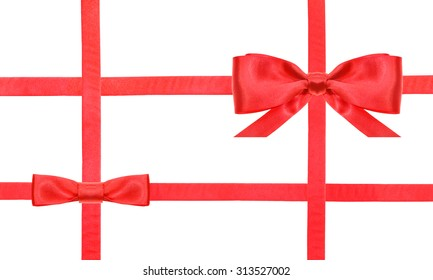 red satin bow and knot and four intersecting ribbons isolated on horizontal white background
