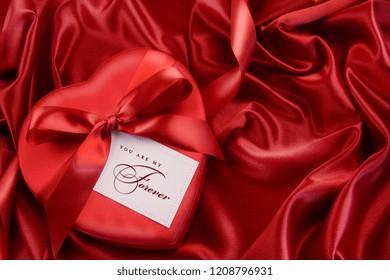 Red satin ribbon gift heart beautiful bow