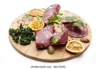 Red sausage with lemon and mint
