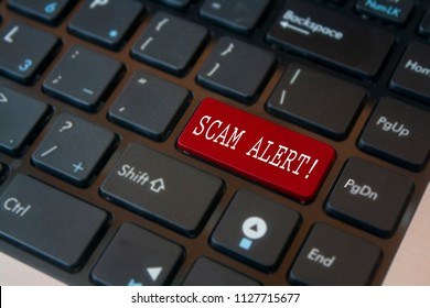 Red scam alert keyboard button with blurred effect