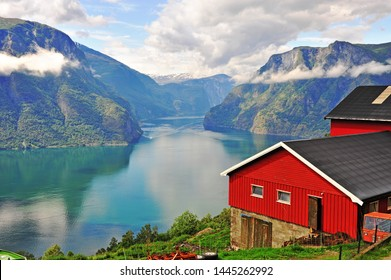 Red scandinavian house over Sognefjord, Norway