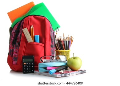 red school backpack with school supplies  on a white isolated background