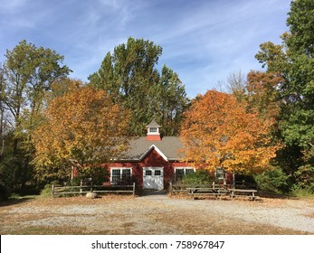 Red schoolhouse in the country. Fall scene.