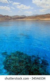 Red Sea, Aqaba gulf, Egypt. Mountain and coral reef.
