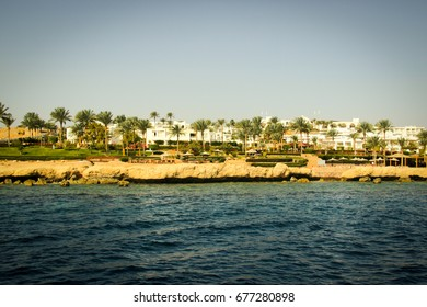 Red sea, coastline with hotels and palm trees
