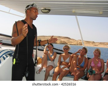 RED SEA, EGYPT- SEPTEMBER 09:  Arab dive-instructor give diving lesson to tourists before diving in the Red sea September 09, 2009 in Charm el Sheikh, Egypt