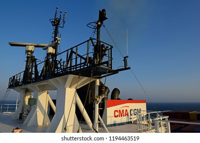 red sea, international waters - january 03, 2015: funnel and monkey island with antennas of container vessel cma cgm vela (imo  9354923)