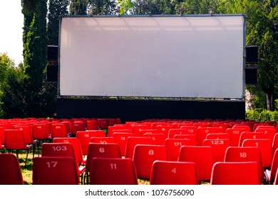red seats of outdoor public cinema