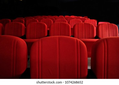 red seats in a small cinema