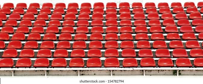 Red seats in stadium.
