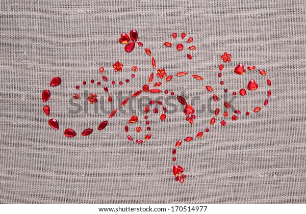 red sequins floral ornament on the fabric texture, as background