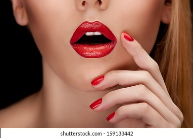 Red Sexy Lips and Nails closeup.